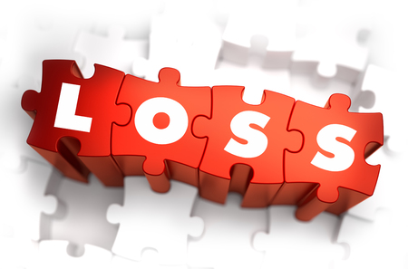 Loss - Text on Red Puzzles with White Background and Selective Focus. photo