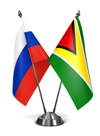 co operative: Russia and Guyana - Miniature Flags Isolated on White Background.