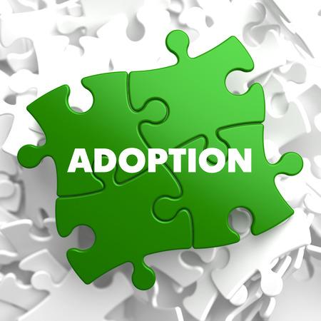 undertaking: Adoption on Green Puzzle on White Background.
