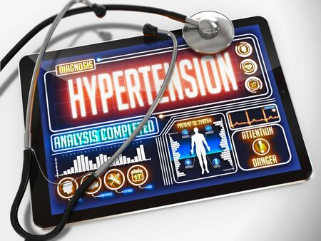 Hypertension - Diagnosis on the Display of Medical Tablet and a Black Stethoscope on White Background.