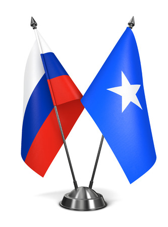 somalian culture: Russia and Somalia - Miniature Flags Isolated on White Background. Stock Photo