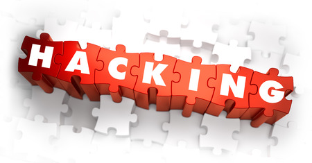 Hacking - Text on Red Puzzles on White Background. Selective Focus.