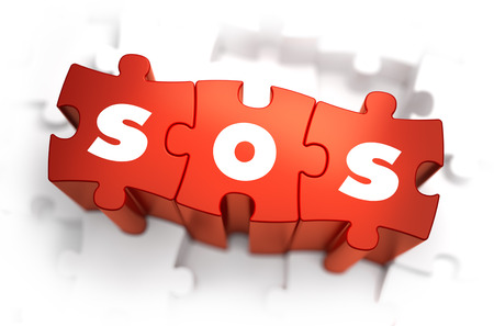miserable: SOS - Text on Red Puzzles with White Background and Selective Focus.