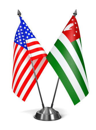 disputed: USA and Abkhazia - Miniature Flags Isolated on White Background.