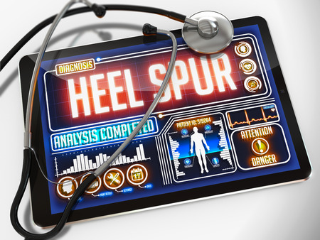 plantar: Heel Spur - Diagnosis on the Display of Medical Tablet and a Black Stethoscope on White Background.