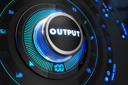 output: Output Controller on Black Control Console with Blue Backlight. Increase, improvement, control or management concept.