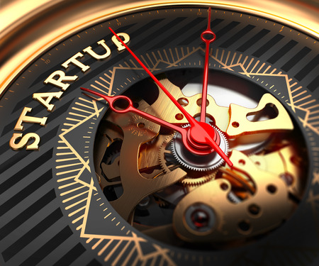 blast off: Startup on Black-Golden Watch Face with Closeup View of Watch Mechanism. Stock Photo
