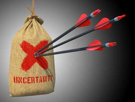 suspense: Uncertainty - Three Arrows Hit in Red Target on a Hanging Sack on Grey Background.