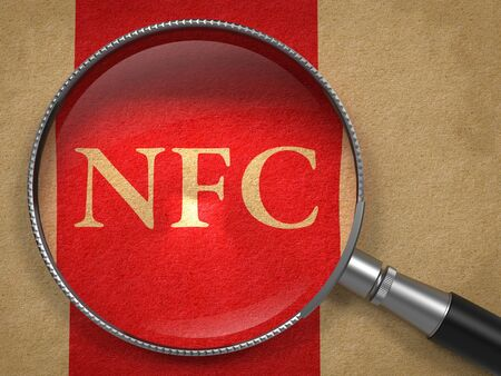 nfc: NFC through Magnifying Glass on Old Paper with Red Vertical Line. Stock Photo
