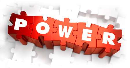 dominating: Power - Text on Red Puzzles with White Background and Selective Focus.