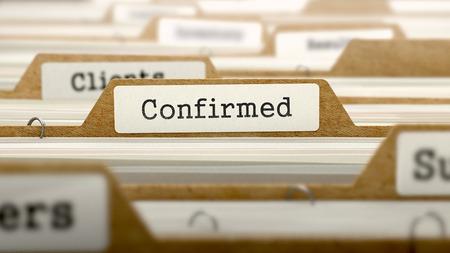 confirmed: Confirmed Word on Folder Register of Card Index. Selective Focus.