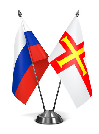 guernsey: Russia and Guernsey - Miniature Flags Isolated on White Background. Stock Photo