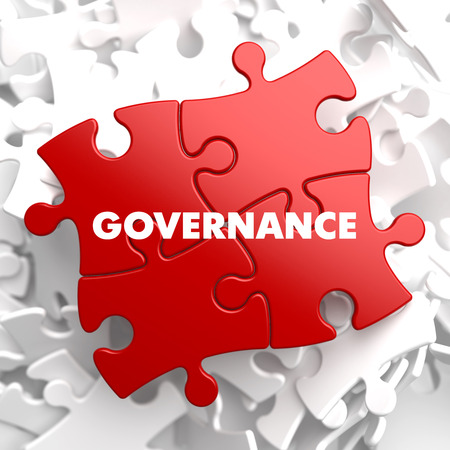 governance: Governance op Red puzzel op witte achtergrond. Stockfoto