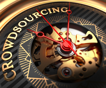 Crowdsourcing on Black, Golden Watch Face with Closeup View of Watch Mechanism. Stock Photo