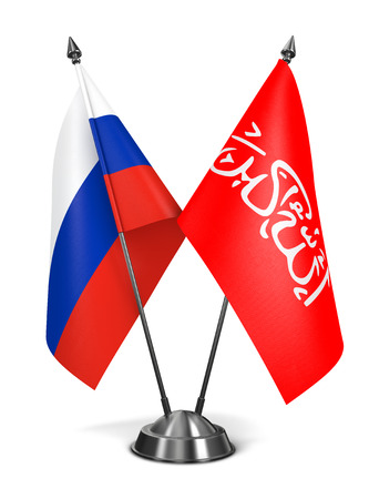 taliban: Russia and Waziristan - Miniature Flags Isolated on White Background. Stock Photo