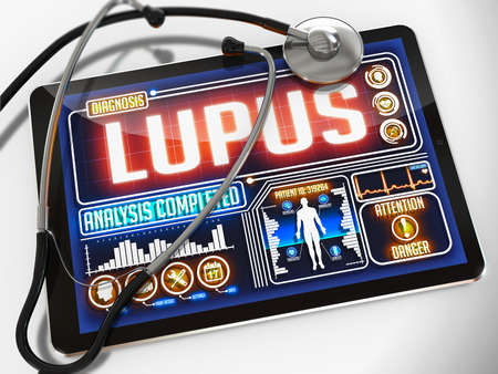Lupus - Diagnosis on the Display of Medical Tablet and a Black Stethoscope on White Background. photo