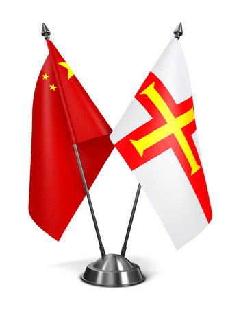 guernsey: China and Guernsey - Miniature Flags Isolated on White Background.