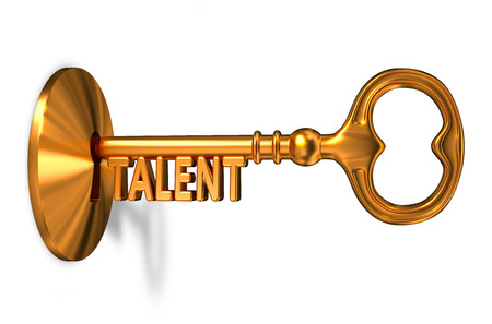 Talent - Golden Key is Inserted into the Keyhole Isolated on White Background