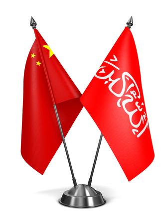 taliban: China and Waziristan - Miniature Flags Isolated on White Background.