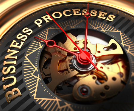 formalization: Business Processes on Black-Golden Watch Face with Watch Mechanism. Full Frame Closeup.