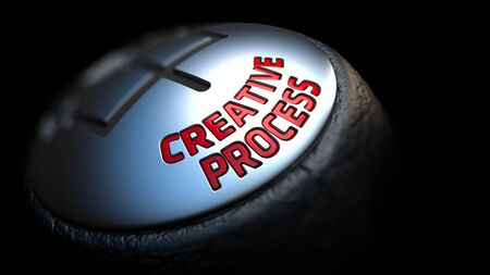 afflatus: Creative Process - Red Text on Cars Shift Knob on Black Background. Close Up View. Selective Focus.
