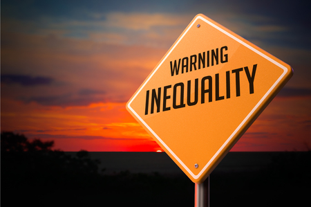 unbiased: Inequality on Warning Road Sign on Sunset Sky Background. Stock Photo