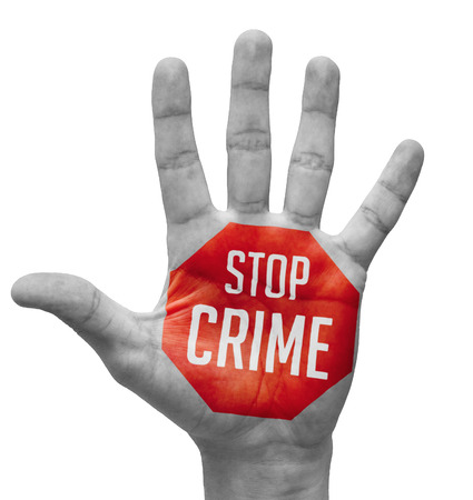 confiscation: Stop Crime Sign in Red Polygon on Pale Bare Hand. Isolated on White Background.