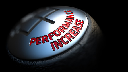 Performance Increase. Shift Knob with Red Text on Black Background. Close Up View. Selective Focus. 3D Render.