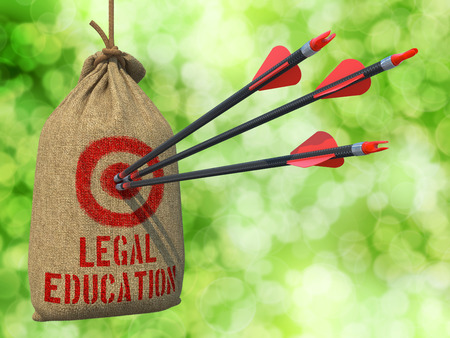 business sign: Legal Education - Three Arrows Hit in Red Target on a Hanging Sack on Natural Bokeh Background.