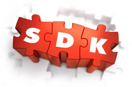 dissemination: SDK - Software Development Kit - Text on Red Puzzles with White Background. 3D Render. Stock Photo