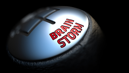 brain storm: Gear Stick with Red Text Brain Storm on Black Background. Close Up View. Selective Focus. Control Concept.