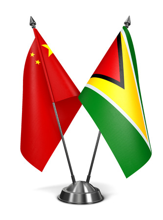 co operative: China and Guyana - Miniature Flags Isolated on White Background.