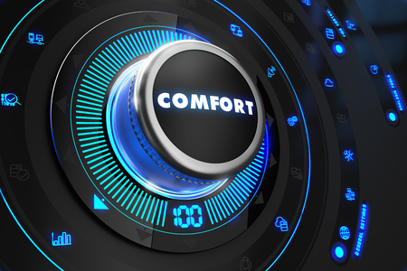 Comfort Regulator on Black Control Console with Blue Backlight. Improvement, Regulation, Control or Management Concept. Stock Photo