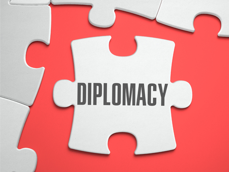 diplomacy: Diplomacy - Text on Puzzle on the Place of Missing Pieces. Scarlett Background. Close-up. 3d Illustration.