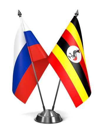 kampala: Russia and Uganda - Miniature Flags Isolated on White Background.