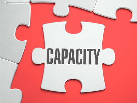 upgrading: Capacity - Text on Puzzle on the Place of Missing Pieces. Scarlett Background. Close-up. 3d Illustration. Stock Photo