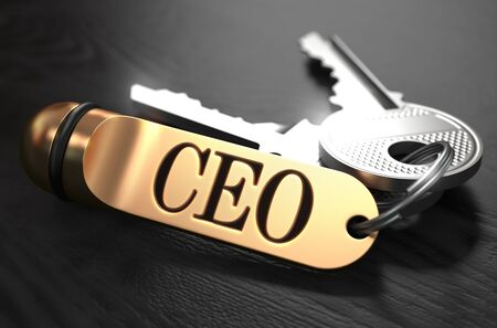 motivator: CEO - Chief Executive Officer - Bunch of Keys with Text on Golden Keychain. Black Wooden Background. Closeup View with Selective Focus. 3D Illustration. Stock Photo