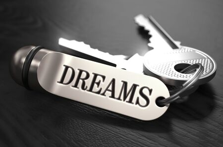 selective focus: Keys to Dreams - Concept on Golden Keychain over Black Wooden Background. Closeup View, Selective Focus, 3D Render. Black and White Image. Stock Photo