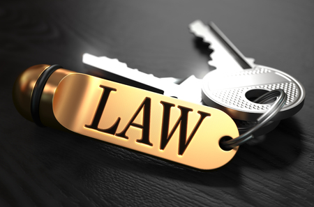 rightfulness: Law Concept. Keys with Golden Keyring on Black Wooden Table. Closeup View, Selective Focus, 3D Render. Toned Image.
