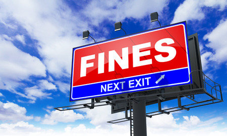 Fines Inscription on Red Billboard on Sky Background. Stock Photo