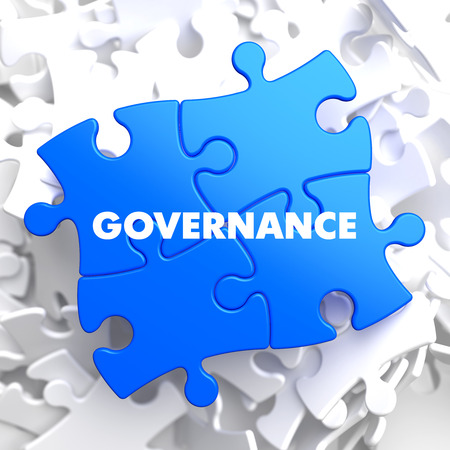 government regulations: Governance on Blue Puzzle on White Background. Stock Photo