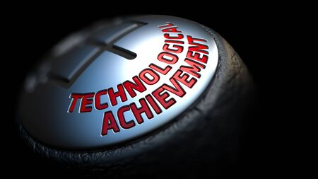 technological: Technological Achievement - Red Text on Black Gear Shifter with Leather Cover. Close Up View. Selective Focus.