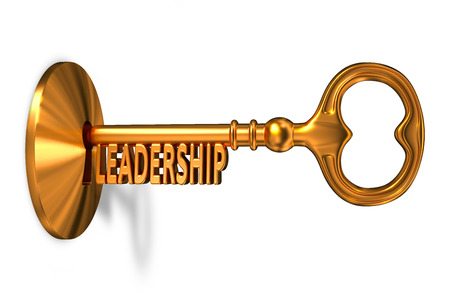 leadership key: Leadership - Golden Key is Inserted into the Keyhole Isolated on White Background Stock Photo