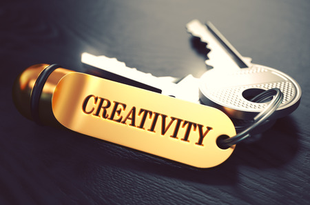 originative: Keys with Word Creativity on Golden Label over Black Wooden Background. Closeup View, Selective Focus, 3D Render. Toned Image. Stock Photo