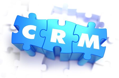 relationship management: CRM - Customer Relationship Management - White Word on Blue Puzzles on White Background. 3D Render.