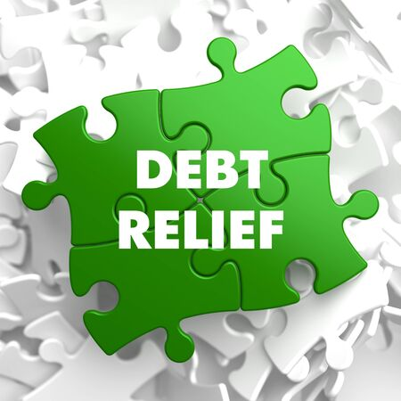 restructuring: Debt Relief on Green Puzzle on White Background.