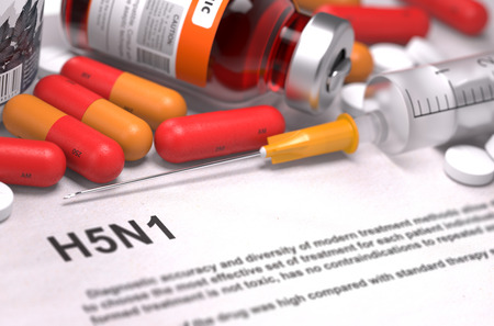 neuraminidase: H5N1 - Printed Diagnosis with Blurred Text. On Background of Medicaments Composition - Red Pills, Injections and Syringe.