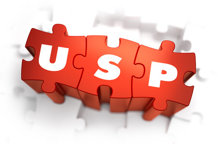 unique selling proposition: USP - Unique Selling Point - White Word on Red Puzzles on White Background. 3D Illustration.