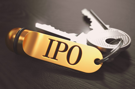 initial public offering: IPO - Initial Public Offering - Concept. Keys with Golden Keyring on Black Wooden Table. Closeup View, Selective Focus, 3D Render. Toned Image.