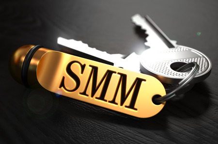smm: SMM - Social Media Marketing - Concept. Keys with Golden Keyring on Black Wooden Table. Closeup View, Selective Focus, 3D Render.